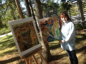 Joanie beside her rendition of Frank Carmichael's painting