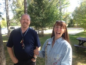Joanie laughing with old classmate Rick Gibson