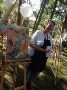 Winner of the art battle stands with her painting