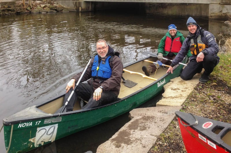 Patrick McLean(bow) and Richard Wells(stern) accompany the McGuffins on a paddle up the Kalamazoo River as part of their visit to the College.