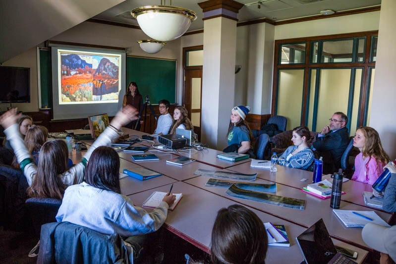 The McGuffins lecturing in Professor Patrick McLean's Canadian studies class following their field trip to the McMichael Gallery, the National Gallery of Canada, the Art Gallery of Ontario and the Canadian Canoe Museum.